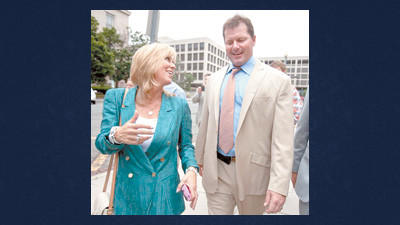 Debbie Clemens, left, smiles while leaving federal court with her husband, former Major League Baseball pitcher Roger Clemens in Washington Monday after he was acquitted on all charges by a jury that decided that he didn't lie to Congress when he denied using performance-enhancing drugs.