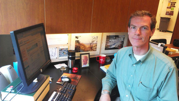 Bill Taylor is shown at his desk at the temporary Washington County Free Library headquarters off Western Maryland Parkway. A picture of his spouse, Mark Noble, is in a frame on his desk.