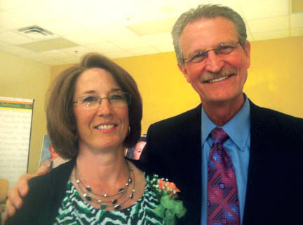 "Jodi Kissner, left, is congratulated by William F. ""Bill"" Queen, president of the Berkeley County Board of Education, after she was named Berkeley County Schools Teacher of the Year during a ceremony Monday night."