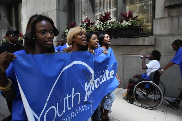 Supporters of Youth Advocate Programs protest cuts in funding Monday at City Hall.