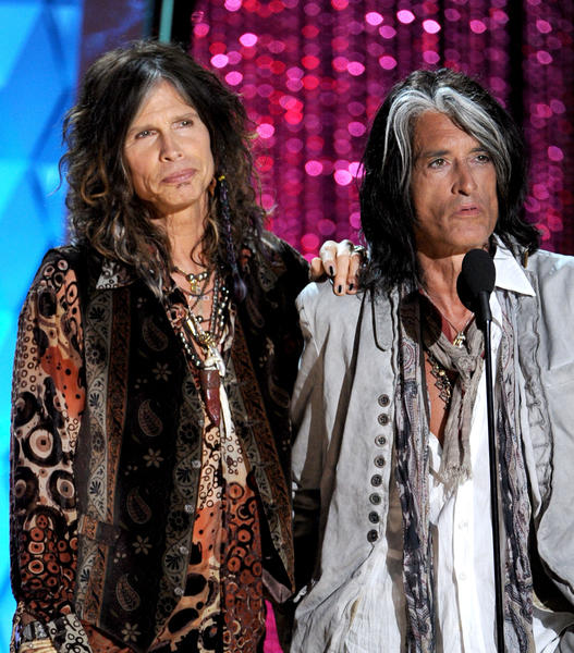 Steven Tyler and Joe Perry of Aerosmith present an award during the 2012 MTV Movie Awards in Universal City, Calif. on June 3.