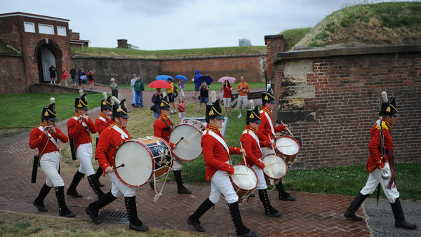 "The Fort McHenry Guard musicians march to the ""From Enemies to Allies: 200 Years of Peace"" ceremony at Fort McHenry. The event launched the bicentennial commemoration of the War of 1812."