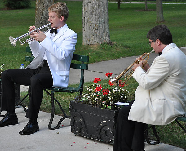 Trumpet players (from left) Johannes Stegmann and Scott Thornburg practice outdoors on the Bay View campus.