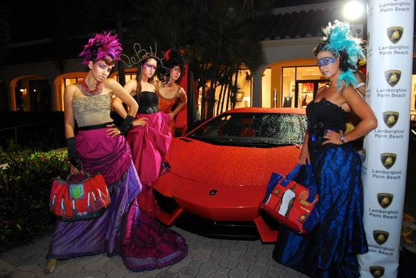 "Models with the Lamborghini Aventador LP 700-4 during the second annual ""Martinis and Lamborghinis"" event, which was sponsored by Lamborghini Palm Beach and raised nearly $10,000 for the Leukemia & Lymphoma Society. To see more photos from Society Scene's Palm Beach edition, visit www.Facebook.com/SocietyScene."