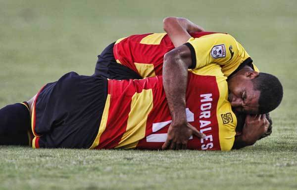"Andy Herron comforts Striker teammate Polo Morales after Polo's injury to his leg. Morales fractured both his tibia and fibula during the Strikers' 1-0 victory over FC Edmonton on Saturday at Lockhart Stadium. He had surgery at Broward General Hospital and is home resting. His rehabilitation will begin soon. <a href=""http://www.sun-sentinel.com/sports/soccer/fl-strikers-notes-0619-20120618,0,5204895.story""><font color=""red"">Click here</font></a> to read more on the story."