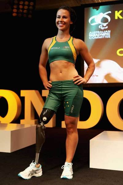 Paralympian Kelly Cartwright showcases the 2012 Australian Paralympic team uniform on the catwalk on day two of Mercedes-Benz Fashion Week Australia Spring/Summer 2012/13 at Overseas Passenger Terminal on May 1, 2012 in Sydney, Australia.