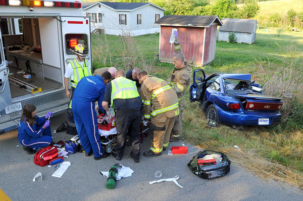 Medical personnel with Winchester Fire-EMS, Clark County Fire Department and Air Methods of Kentucky treat 18-year-old Nicholas Hall who was seriously injured today when his car struck a tree around 8 a.m. The wreck happened about two miles from Winchester near Browning Lane on Muddy Creek Road. Clark County Deputy Sheriff Paul Howard said it appeared Hall's car left the road and struck a tree stump. Hall was taken to the University of Kentucky Medical Center with possible head injuries, Howard said.