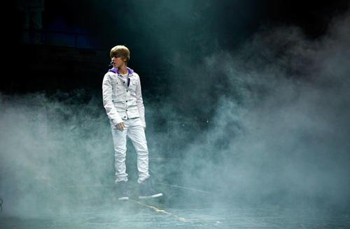 "Justin Bieber appears out of the mist at the start of his concert at the Nokia Theatre L.A. Live.<br> <br> <b>RELATED:</b><br> <br> <a href=""http://latimesblogs.latimes.com/music_blog/2010/07/live-review-justin-bieber-at-nokia-theater-la-live.html"">Live Review: Justin Bieber at Nokia Theater L.A. Live</a>"