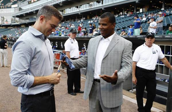 Chicago Cubs President of baseball operations Theo Epstein, left, with Chicago White Sox General Manager Kenny Williams, chat during batting practice, before the start of the game at U. S. Cellular Field