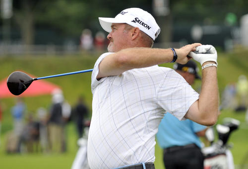 Jerry Kelly, former University of Hartford grad, hits on the practice range at the TPC River Highlands Tuesday as they prepare for the 2012 Travelers Championship in Cromwell.