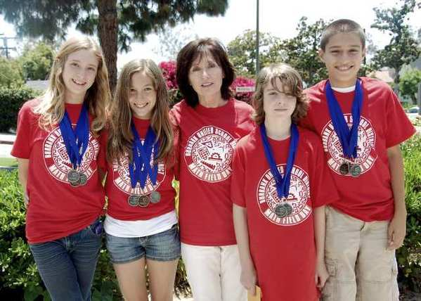 Winners of three medals during the Math Field Day competition are, from left, Bene Snyder, Melissa Daniel, Coach Hope Forrestel, Callum Campbell and Hakob Shamilian.