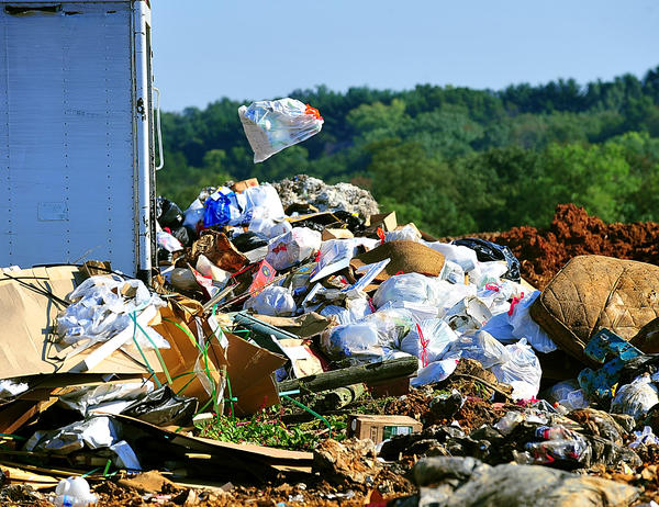 In this Herald-Mail file photo, a bag of trash is tossed from a vehicle in the commercial dumping area at Washington County 40 West landfill. Washington County plans to lease up to 130 acres at its Forty West and Resh Road landfills for EPG's 25-megawatt solar development.