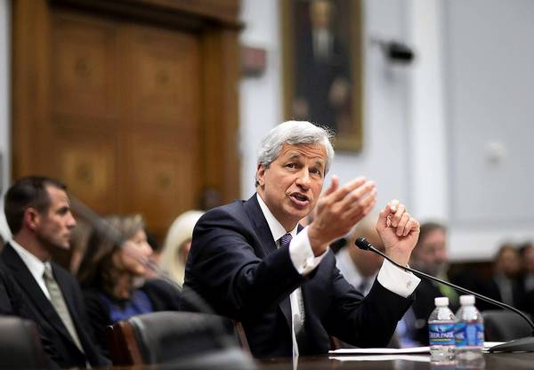 JPMorgan Chase CEO Jamie Dimon testifies at a House Financial Services Committee hearing Tuesday in Washington. It was the second time in less than a week that he testified on Capitol Hill about JPMorgan's more than $2-billion trading loss. Dimon faced tougher questions from Democrats and Republicans than he did from the Senate Banking Committee last week.