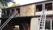 Three displaced after two-alarm fire damages Columbia home