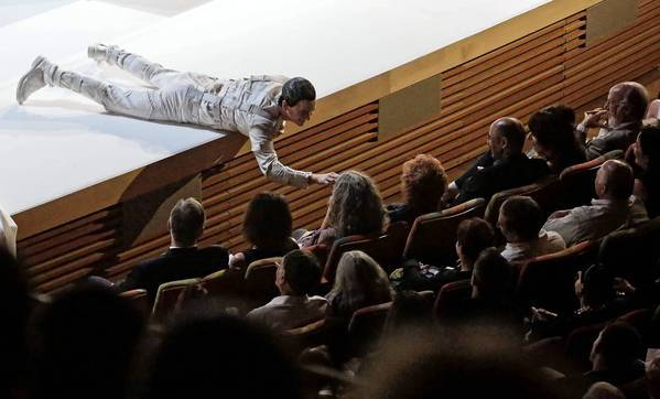 "In the guise of an antic Leporello, Kevin Burdette engages the audience during a performance of the L.A. Phil's ""Don Giovanni."""