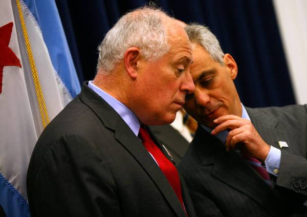 "Mayor Rahm Emanuel, right, talks with Gov. Pat Quinn at a Tuesday news conference at City Hall. Also Tuesday, Emanuel discussed his plan to allow police to write tickets for those possessing small amounts of marijuana. ""It's not decriminalization, its dealing with it in a different way and a different penalty,"" he said."
