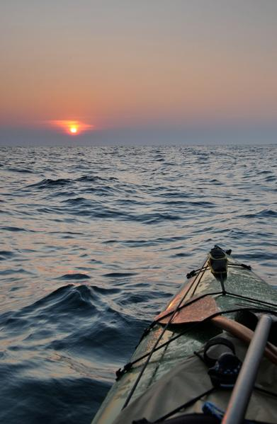 Stephen Brede's canoe is pointed into the setting sun near Bruce Peninsula, Ont., during his 2010 circumnavigation of Lake Huron