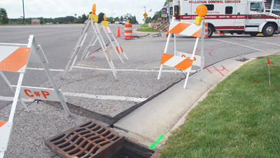 Barricades block the right turn lane of Sheridan Street west at the U.S. 31 junction at the top of the hill, this morning in Petoskey. The barricades shield a section of pavement that has lifted five inchesfrom the roadbed and could cause damage to automobiles. Technicians are on the scene with scopes trying to determine the cause of the damage and determine a plan for repair.