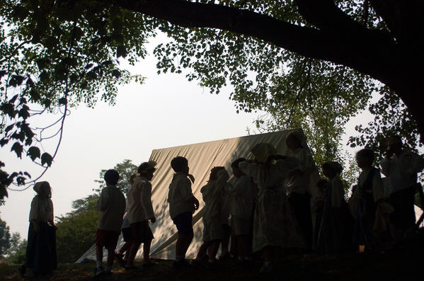 In a 2006 file photo, kids at a camp walk past a tent in Edgewater.