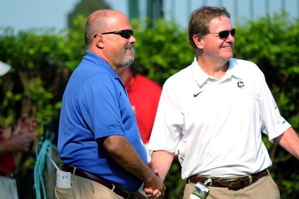 "WTIC radio ""Voice of the Huskies"" Joe D'Ambrosio (left) greets UConn men's basketball associate head coach George Blaney (right) before Blaney tees off in the Celebrity Pro Am at the Travelers Championship at TPC River Highlands in Cromwell Thursday."
