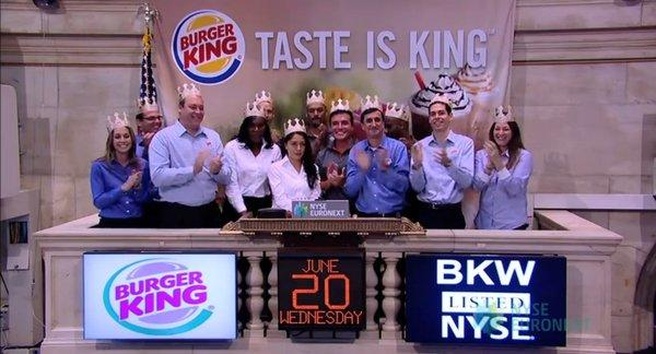 Burger King staffers celebrate the company's relisting, ringing the opening bell on trading Wednesday at the New York Stock Exchange.