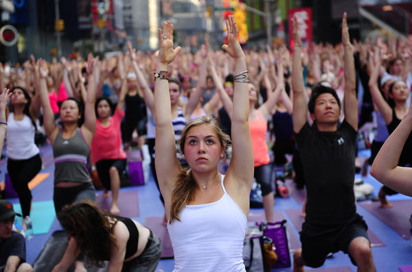 Participants take part in a mass yoga class to mark the summer solstice on Times Square in New York, June 20, 2012. Thousands of yogis gathered on Times Square to celebrate the longest day of the year during the event which features four free mass yoga session at the heart of Manhattan.