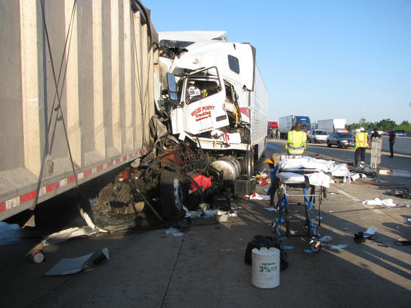 Emergency responders work at the scene of a crash on Interstate 80 this morning.