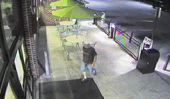 This image from a surveillance video released by Maryland State Police shows a man sought in connection with an armed robbery at the Sheetz store on Lager Drive in Huyetts entering the store Wednesday morning.