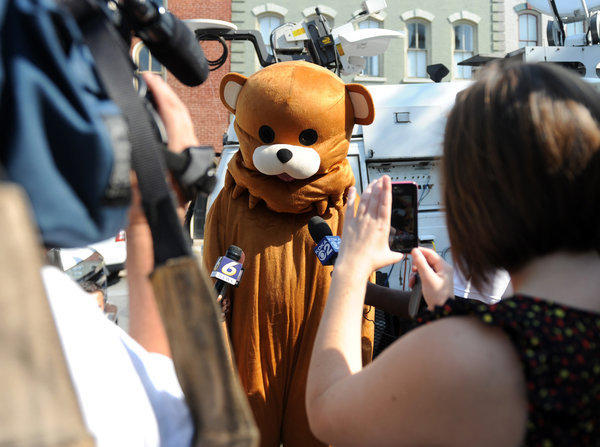 "Someone dressed as ""Pedobear"" talks to reporters while Jerry Sandusky's trial was going on inside at the Centre County Courthouse in Bellefonte on Wednesday."
