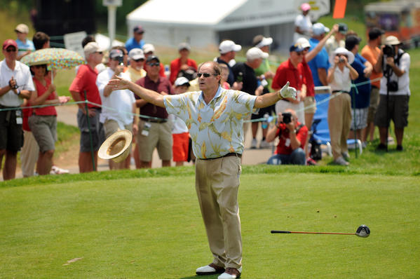 ESPN announcer and commentator Chris Berman drops his hat and club after his shot off the first tee at the Celebrity Pro Am at the Travelers Championship at TPC River Highlands in Cromwell Thursday.