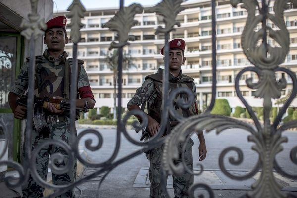 Egyptian soldiers stand guard Wednesday outside Cairo's Maadi Armed Forces Hospital, where former President Hosni Mubarak was receiving medical treatment while serving his prison sentence.