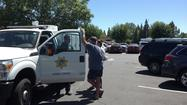 A dog was rescued from a hot car Wednesday afternoon at a mall parking lot, as temperatures crept above 90 degrees outside.