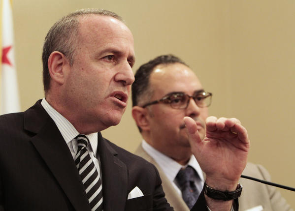 State Sen. President Pro Tem Darrell Steinberg (D-Sacramento), left, discusses the state budget during a news conference with Assembly Speaker John Perez (D-Los Angeles) at the Capitol.