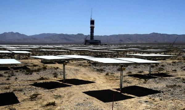 An Ivanpah power plant tower is surrounded by mirrors, which will bounce radiation from the sun to it. Water stored inside the towers will be heated to 1,000 degrees, creating steam power.