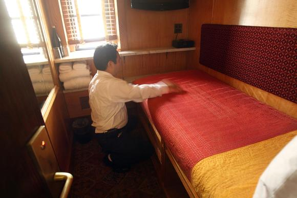 Tsering, a maid, makes a bed at the Jane Hotel, a new hotel built around the concept of budget conscious travel with style on March 23, 2009 in New York City. Hotels with modern amenities and tiny budget rooms have been fashionable for years and Europe while slowly gaining popularity in America.
