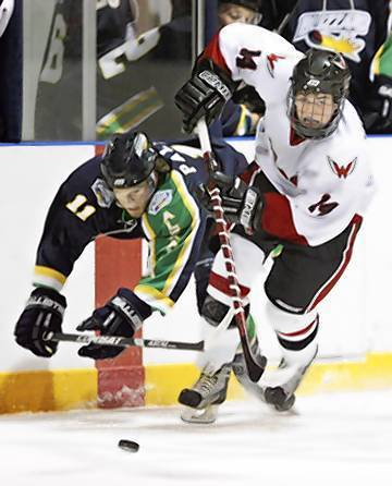 Cullen Hurley of the Aberdeen Wings gets the better of a collision with Jordan Palusky (left) of the Alexandria Blizzard last season as they chase a loose puck. Hurley was recently drafted by the United States Hockey League. American News File Photo by John Davis