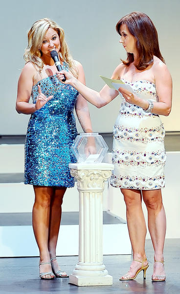 Miss Smithsburg Lindsay Karroll, left, introduces herself to Miss America 1981 Susan Powell before answering her random question in the on-stage interview event Wednesday night during the first night of  the 2012 Miss Maryland Scholarship Pageant at The Maryland Theatre in Hagerstown. The pageant continues tonight with preliminaries in the Miss Maryland and Miss Maryland Outstanding Teen competition.