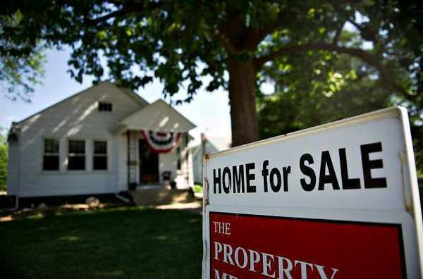 Home resales slipped in May from April but are up substantially from a year earlier.