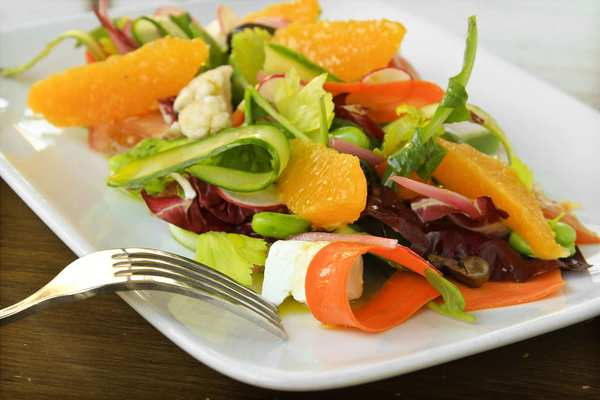 A seasonal salad is made with fava beans and Valencia oranges.