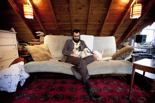Jason Adasiewicz with his dog Leeza in his attic studio at his home in Chicago.