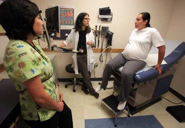A prenatal exam is performed at the North Portland Health Center in Portland, Ore. Healthcare jobs are expected to boom by 2020, but most unemployed Americans won't have the schooling necessary to land them.