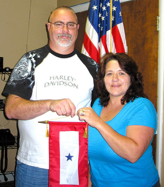 Steve and Shelly (Sue) Haskell of Dargan display the Blue Star Banner they received from American Legion Auxiliary Unit 236 on behalf of their son C.J., who is deployed to Afghanistan.