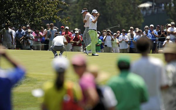 The group of (L to R) Bubba Watson, Keegan Bradley and Webb Simpson drew the largest gallery during the first round of the 2012 Travelers Championship golf tournament at the TPC River Highlands in Cromwell Thursday. Simpson, who won the US Open last weekend, acknowledges the gallery after making a birdie on the first hole.