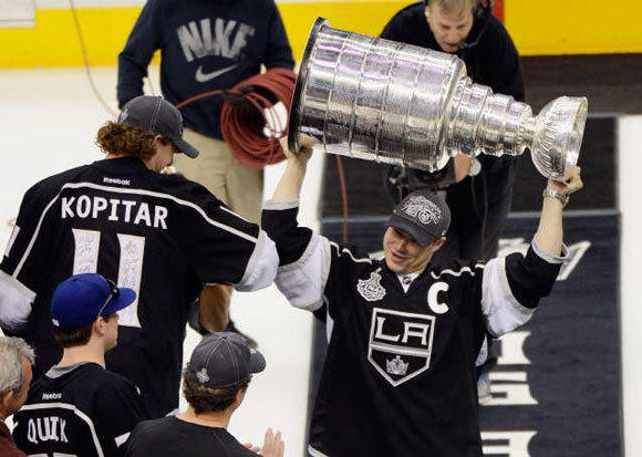 Kings captain Dustin Brown holds up the Stanley Cup.