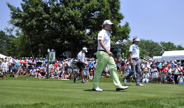 Webb Simpson, US Open champ, and Bubba Watson, Masters and 2010 Travelers champ walk off the first tee during the first round of the 2012 Travelers Championship golf tournament at the TPC River Highlands in Cromwell Thursday. Keegan Bradley, the 2011 PGA Championship winner, filled out the marquis trio.