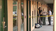 Police at a Dolton motel where a young woman was found beaten to death Wednesday. WGN-TV