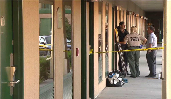Police at a Dolton motel where a young woman was found beaten to death Wednesday.
