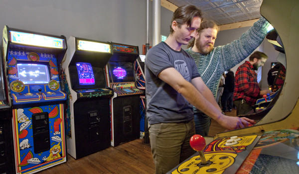 Carter Obrien (left), of Avondale, and Patrick Russell, of Edgewater, play games at Logan Hardware arcade, 2410 W Fullerton.