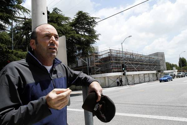 Jeff Gantman stands across from a synagogue in Sherman Oaks that is undergoing a controversial expansion.