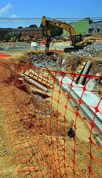 Work progresses Thursday for a new pedestrian underpass beneath Duke Street in Shepherdstown, W.Va.